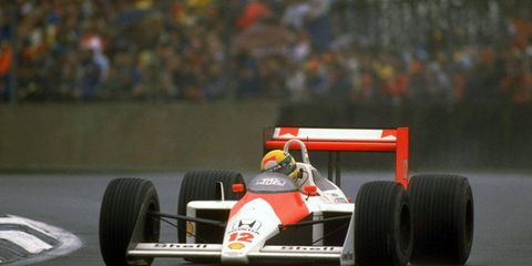 Ayrton Senna took home the rain-soaked 1988 British Grand Prix trophy, edging out Nigel Mansell to win.