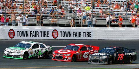 Kyle Busch (18), Juan Pablo Montoya (42) and Kurt Busch (78) go three-wide racing in New Hampshire on Sunday.