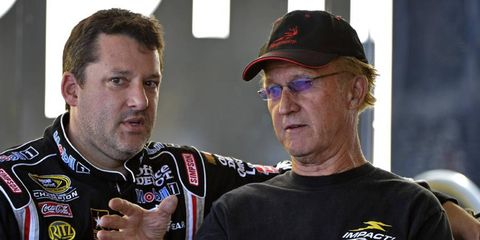 Morgan Shepherd, shown talking to Tony Stewart, will race in both the Sprint Cup and Nationwide races this weekend.