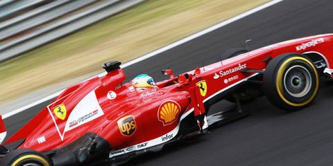 Will Fernando Alonso be trading in his Ferrari red for Red Bull Racing colors next year?