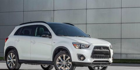 The 2013 Mitsubishi Outlander Sport is shown.