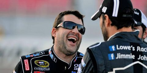 Tony Stewart, left, hangs out with Jimmie Johnson during last season's NASCAR Sprint Cup race season at Las Vegas.