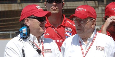 Izod IndyCar Series and NASCAR Sprint Cup Series team owner Chip Ganassi, left, and his father, Floyd, share a moment at the Indianapolis Motor Speedway in 2007.