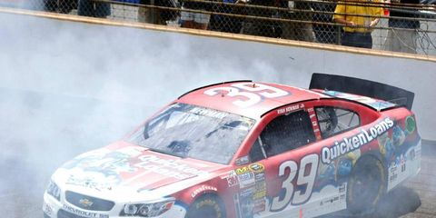 Ryan Newman burns out after a win in Indianapolis. With Tony Stewart sidelined by injury, Newman is Stewart Hass Racing's best chance to make the Chase.