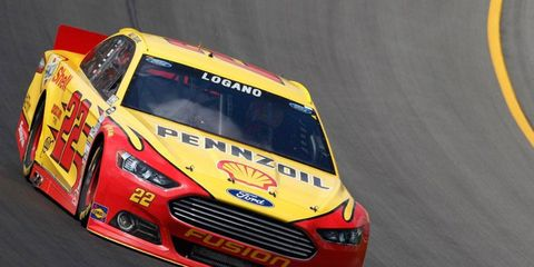 Joey Logano roared to the fastest NASCAR Cup Series qualifying lap at Michigan International Speedway on Friday.