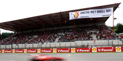 Greenpeace protesters unfurled banners during the Formula One Belgian Grand Prix on Sunday.