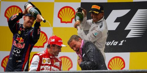 Formula One Belgian Grand Prix podium finishers Sebastian Vettel, Fernando Alonso and Lewis Hamilton give BBC broadcaster and former driver David Coulthard the business after the race on Sunday.