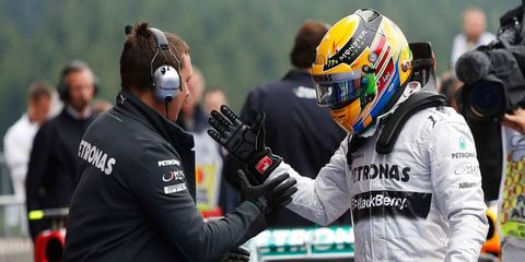 Lewis Hamilton, right, is congratulated after winning the pole position for Sunday's F1 Belgian Grand Prix.