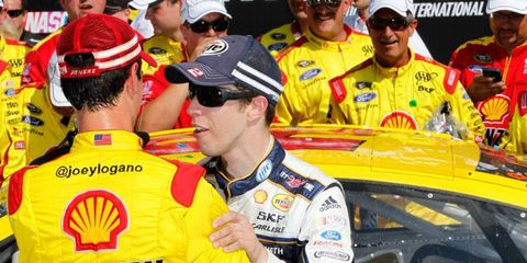 Brad Keselowski congratulates teammate Joey Logano after Logano's Sprint Cup Series race win at Michigan on Aug. 18.