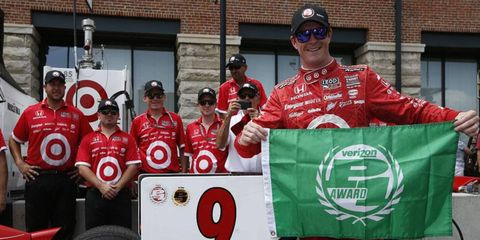 Scott Dixon edged out Will Power to take the pole position for Sunday's IndyCar race in Baltimore.