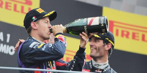 Sebastian Vettel, left, and Red Bull Racing teammate Mark Webber enjoy their time on the podium in Monza after finishing 1-3 in the Italian Grand Prix.
