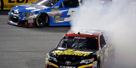 Clint Bowyer loses control of his Toyota Camry and brings out a late caution flag on Saturday night at Richmond.