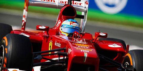 Fernando Alonso got a little help from teammate Felipe Massa and will start fifth in Monza on Sunday.