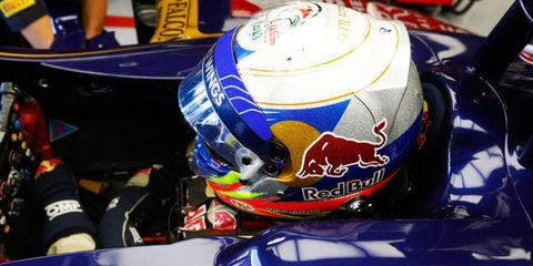 Daniel Ricciardo, shown here inside the cockpit of his Toro Rosso Machine, may need to slim down to fit inside the RB10 for Red Bull next season.