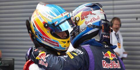 Sebastian Vettel, right, has won an impressive five races this season while Alonso has won just two.