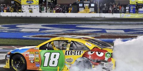Kyle Busch overcame some serious vibrations in his car to win Sunday night's Sprint Cup race at Atlanta Motor Speedway.