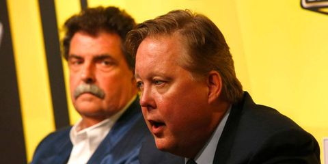 NASCAR chairman Brian France addresses the media at Chicagoland on Friday as Mike Helton looks on.