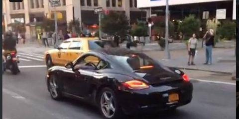 A Porsche Cayman owner awaits a conversation with O'Malley