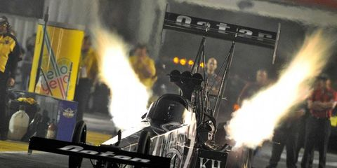 NHRA Countdown contender Shawn Langdon took the provisional top spot in qualifying on Friday at St. Louis.
