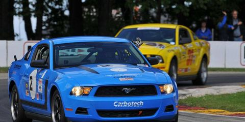 Michael Scornavacchi (2) Mathews, N.C., on his way to a Ford Mustang sweep of T4.  Second place went to Lance Stewart (31) of Miami, Fla.