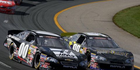 Cole Custer (00) battles Dylan Kwasiniewski for the lead during the NASCAR K&N Pro Series race at New Hampshire on Saturday.