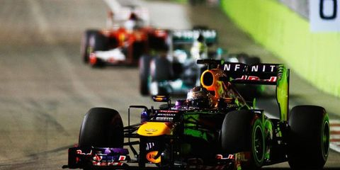 Sebastian Vettel dominated the field in Singapore to win the Formula One race there by more than 32 seconds.