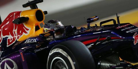 Sebastian Vettel posted a quick time in the third qualifying session and then watched his rivals come up short in their attempt to overtake him for the pole in Singapore.