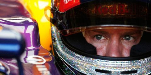 Sebastian Vettel held on for the pole position in Singapore, despite passing on the final flying lap in qualifying.