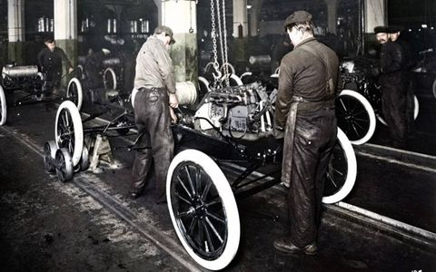 A 1913 Model T takes a ride down the newly invented moving assembly line in the Highland Park Plant. The assembly line was one of the biggest breakthroughs in the American industrial revolution.