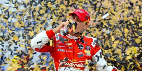 Kevin Harvick is hidden in a sea of confetti on Sunday after his win from the pole at Kansas Speedway.
