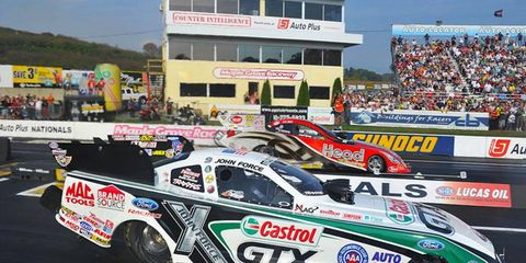 John Force lines up against Chad Head in the Funny Car final on Sunday.