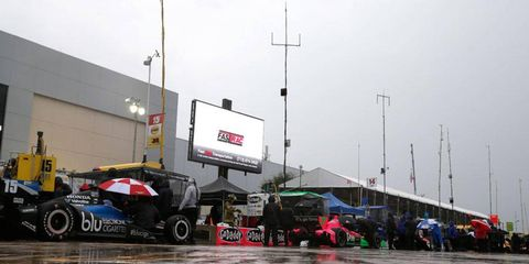 The Indy cars are parked in Houston as rain wiped out Sunday's scheduled qualifying session.