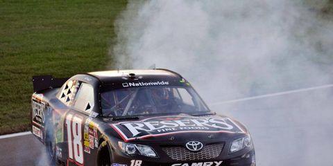 Matt Kenseth celebrates his NASCAR Nationwide Series win at Kansas on Saturday.