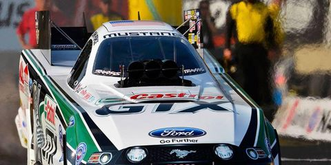 John Force moved a step closer to his 16th NHRA Funny Car championship on Saturday when he secured the top qualifying spot and took over the points lead at Reading.