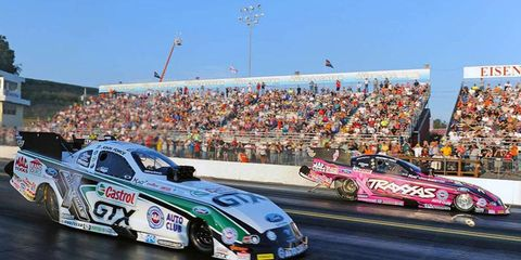 John Force, left, and Courtney Force, right, posted the top NHRA qualifying times on Friday.