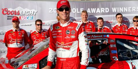 Kevin Harvick celebrates winning the pole for the NASCAR Sprint Cup Series race at Kansas by NOT holding up the Coors Light Pole Award flag. Harvick is sponsored by rival Budweiser.
