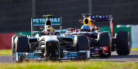 Lewis Hamilton, left, and Sebastian Vettel, right, go through practice on Friday for the Formula One Japanese Grand Prix.
