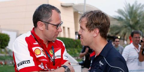 Ferrari F1 principal Stefano Domenicali, left, has been trying to find a way for his drivers to close the gap on Sebastian Vettel, right.