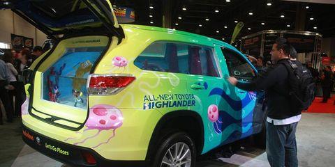 SpongeBob-themed Highlander sports an 800-gallon saltwater tank behind the front seats.