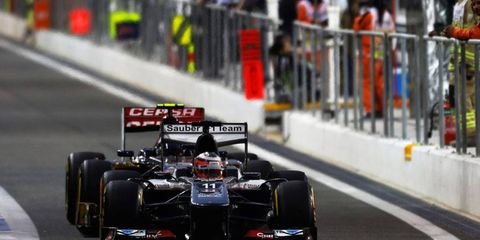Nico Hulkenberg (11) roars out of the pits at Abu Dhabi on Saturday.