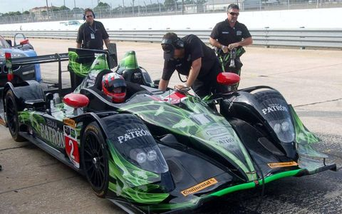 Driver Ryan Dalziel awaits service in the Extreme Patron car, which was shaking down a new Honda engine. Dalziel is a new addition to the Prototype team, co-owned by driver Scott Sharp. This is a car from the American Le Mans Series P2 ranks.