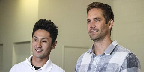 Actor Paul Walker, right, with drifter Ken Gushi recently. Walker was killed in a car crash today.