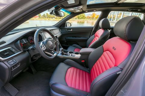 The 2019 Kia Optima SX offers a red and black leather interior, which gets replaced with a bronze and black leather interior on SXL models.
