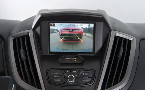 The Ford Sync system, and most others, use the infotainment screen for backup camera purposes.