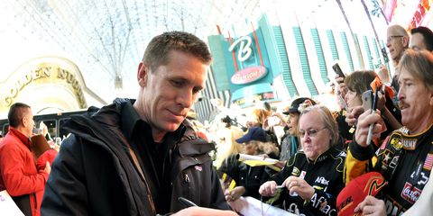 Carl Edwards signs autographs on the red carpet at Fanfest at Fremont Street in Las Vegas.
