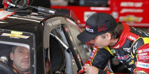 Tony Stewart and Jeff Gordon share a moment during the 2013 season. Gordon, now retired, said that NASCAR needs drivers like Tony Stewart.
