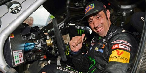 Nani Roma smiles after winning his first Dakar Rally in a car after winning in motorcycles 10 years ago.