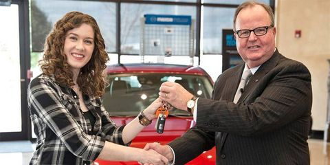 Mazda North America President and CEO Jim O'Sullivan presents Lauren Carter the keys to an even newer Mazda3 than the one she bought.