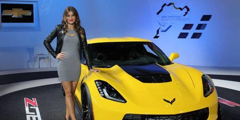 Detroit auto show car models represent a wide spectrum of vehicles, and they're carefully dressed to convey brand images: To wit, the black leather jacket with the Z06 Corvette.