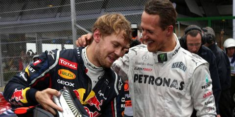 Sebastian Vettel, left, owns the rights to the No. 5 car in the Formula One series. He'll drive No. 1 in 2014 as a perk of winning the championship in 2013.
